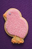 Easter biscuit (pink chick) on purple linen