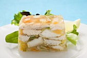Jellied fish, garnished with salad leaves