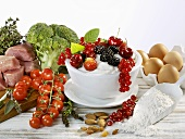 Still life with berries, vegetables, meat, flour, eggs