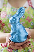 Woman holding Easter Bunny in blue foil