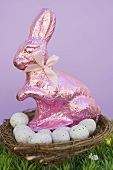 Pink Easter Bunny and Easter eggs in basket