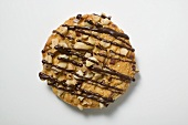 Christmas biscuit with nuts and chocolate drizzle
