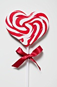 Candy cane lollipop with red bow