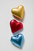 Three chocolate hearts in coloured foil