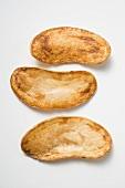 Three home-made potato crisps
