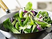 Green vegetables in wok