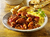 Jalfrezi (spicy meat curry, India) with rice and bread