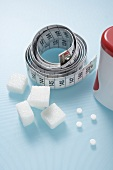 Tape measure, sweetener tablets and sugar cubes