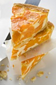 Three pieces of apricot cheesecake