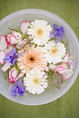 Mixed flowers in a bowl of water