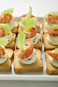 Herb quark, shrimps and celery on toasts