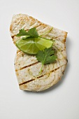 Grilled swordfish steak with lime and coriander leaves