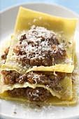 Lasagne with meat sauce and grated cheese