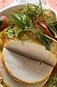 Roast turkey with chillies and herbs, partly carved