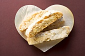 Cantucci (Italian almond biscuits) on heart-shaped plate