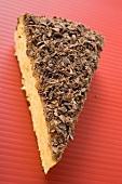 Piece of almond ricotta cake with dark chocolate