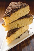 Three pieces of almond ricotta cake with dark chocolate