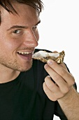 Man eating a fresh oyster