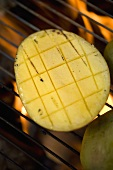 Mango on barbecue grill rack