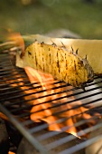 Pineapple on barbecue grill rack