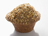 Muffin topped with chopped nuts