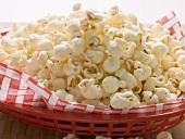 Popcorn on napkin in red plastic basket