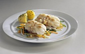 Monkfish on julienne vegetables with parsley potatoes