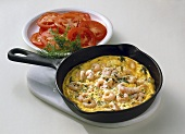 Scrambled egg with shrimps and tomato salad