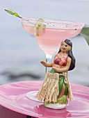 Pink cocktail with Hawaiian dancing girl