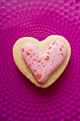 Heart-shaped biscuit with pink icing