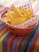 Tortilla chips in a plastic basket