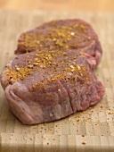 Two seasoned beef medallions