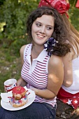 Young woman with doughnuts at a 4th of July picnic (USA)