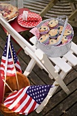 Blueberry muffins on a garden chair, 4th of July (USA)