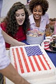 Two women admiring 4th of July cake (USA)