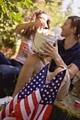 Couple with popcorn in wooden bucket on the 4th of July (USA)