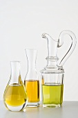 Three different types of oil in carafes