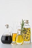 Various types of oil in carafes & bottle of balsamic vinegar