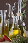 Various types of oil in carafes and bottles