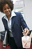 Woman in office with Asian noodle box