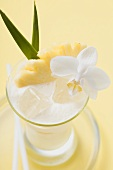 Piña Colada with pineapple and white orchid