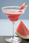 Watermelon drink in a glass with a sugared rim