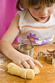 Child with dough and biscuit cutters