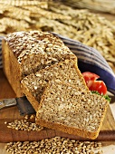 Oatmeal bread with sunflower seeds, partly sliced