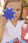 Small girl holding a star cookie (4th of July, USA)