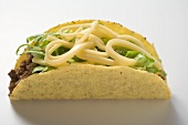 Taco filled with mince, lettuce and cheese