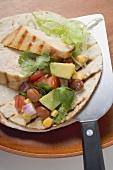 Chicken fajita with chicken breast and salsa on spatula