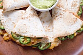 Tortillas with chilli and cheese filling, guacamole