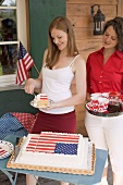 Two women with cake and coffee on the 4th of July (USA)