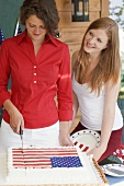 Woman cutting cake on the 4th of July (USA)